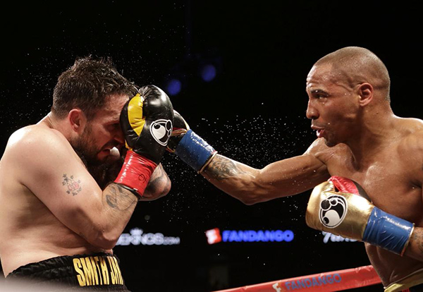 Andre Ward, right, punches Paul Smith during the fifth round of a cruiserweight boxing match in Oakland, Calif., Saturday, June 20, 2015. Ward won when Smith's corner threw in the towel in the ninth round. (AP Photo/Jeff Chiu)