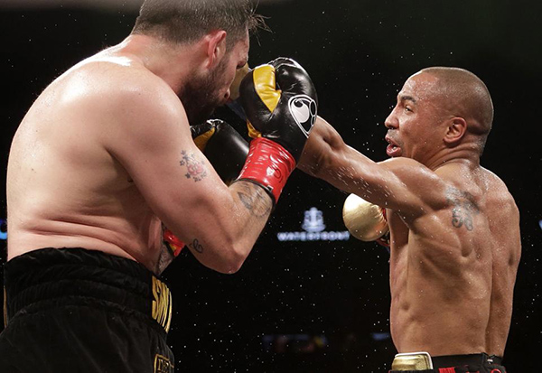 Andre Ward, right, punches Paul Smith during the fourth round of a cruiserweight boxing match in Oakland, Calif., Saturday, June 20, 2015. Ward won when Smith's corner threw in the towel in the ninth round. (AP Photo/Jeff Chiu)