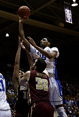 FILE - In this Dec. 15, 2014, file photo, Duke's Jahlil Okafor, top, shoots over Elon's Tony Sabato and Ryan Winters (32) during the first half of an NCAA college basketball game in Durham, N.C. The Los Angeles Lakers may snare Okafor at No. 2 in the NBA draft on Thursday, June 25, 2015. (AP Photo/Gerry Broome, File)