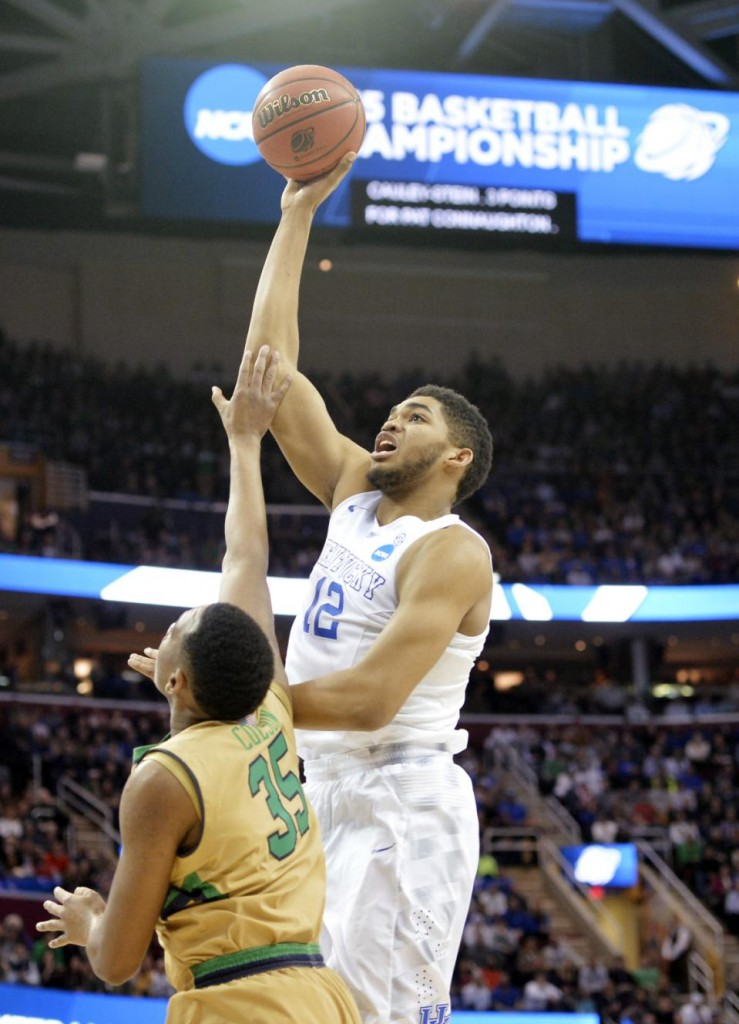 FILE - In this March 28, 2015, file photo, Kentucky's Karl-Anthony Towns (12) shoots over Notre Dame's Bonzie Colson (35) in the first half of a college basketball game in the NCAA men's tournament regional finals in Cleveland. Towns seems the likely pick by the Minnesota Timberwolves at No. 1 in the NBA draft on Thursday, June 25, 2015. (AP Photo/David Richard. File)