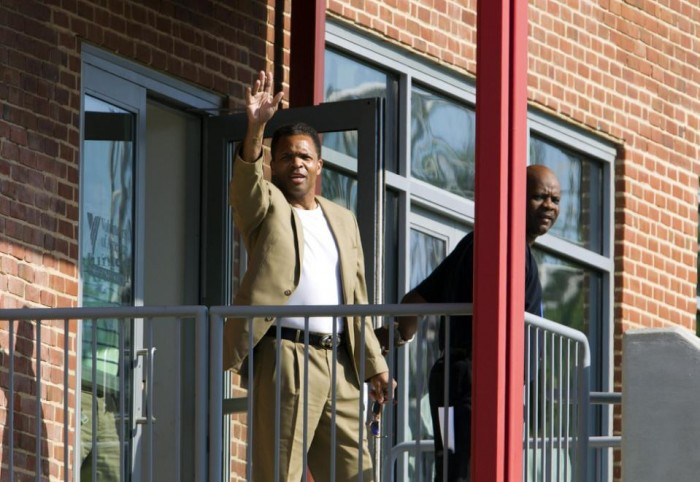 Former U.S. Rep. Jesse Jackson Jr. leaves the Volunteers of America halfway house in Baltimore, where he'd been living since his release from an Alabama federal prison in March, Monday, June 22, 2015. Jackson was convicted in 2013 for misuse of campaign funds. (AP Photo/Jose Luis Magana)