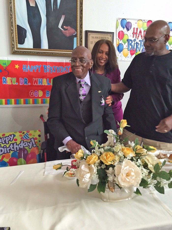 Dr. Whalen Jones enjoys his 106th birthday party with his children, Marlene and David.  (photo by Cora J. Fossett)