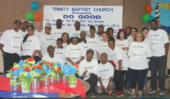 Pastor Alvin Tunstill (back row, center) and the volunteers prepare to serve others.