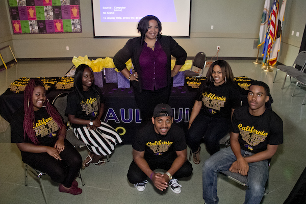 Nicole Ford (center, standing) poses with a few prospective Paul Quinn students.
