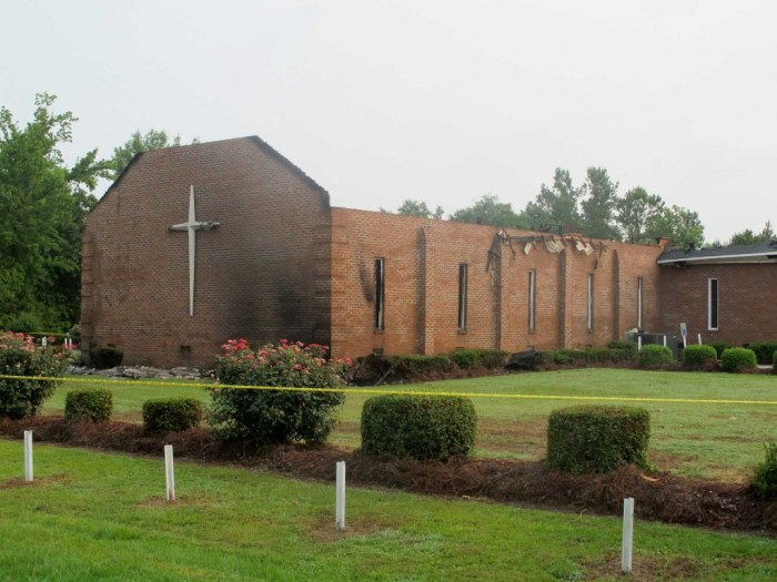 The Mount Zion AME Church in Greeleyville, S.C., is seen on Wednesday, July 1, 2015, after it was heavily damaged by fire. The church was the target of arson by the Ku Klux Klan two decades ago but a law enforcement source told The Associated Press that the most recent fire was not arson. (Photo: Bruce Smith/AP)