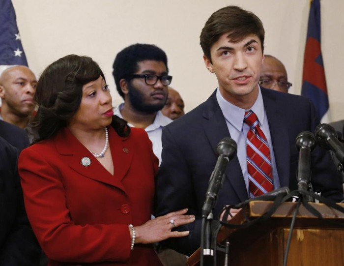 In this March 25, 2015 file photo, Oklahoma state Sen. Anastasia Pittman, left, D-Oklahoma City, stands with Levi Pettit, right, a former University of Oklahoma fraternity member caught on video leading a racist chant, during a news conference at Fairview Baptist Church in Oklahoma City. Pettit apologized for the chant. Sigma Alpha Epsilon, the fraternity connected to the racist video, has announced the hiring of a diversity director who will be charged with helping the fraternity's chapters across the nation become more inclusive. (AP Photo/Sue Ogrocki, File)