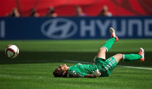Japan goalkeeper Ayumi Kaihori allows a third goal to United States' Carli Lloyd during first-half FIFA Women's World Cup soccer championship action in Vancouver, British Columbia, Canada, on Sunday, July 5, 2015. (Darryl Dyck/The Canadian Press via AP)