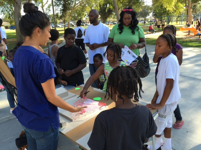 GHEDC and residents gather at a community event held in Ted Watkins Parks. (photo courtesy of GHEDC)