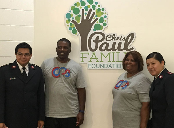 (Left to Right) Lt. Jaun Barriga, Charles Paul, Robin Paul, and Lt. Claudia Pardo-Barriga at the ribbon cutting ceremony for the Live, Learn and Play Center on June 26, 2015 (Amanda Scurlock/LA Sentinel)