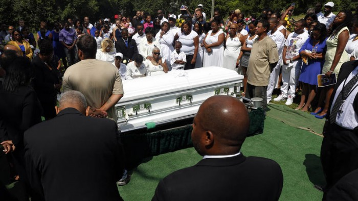 Mourners mourn the death of Sandra Bland at the Mt. Glenwood Memorial Gardens West cemetery Saturday, July 25, 2015, in Willow Springs, Ill. (AP Photo)