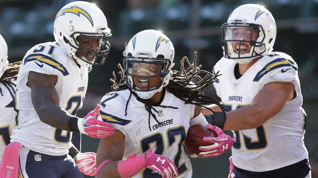 San Diego Chargers cornerback Jason Verrett (22) celebrates with cornerback Richard Marshall, left, and inside linebacker Andrew Gachkar (59) after intercepting Oakland Raiders quarterback Derek Carr during the fourth quarter of an NFL football game in Oakland, Calif., Sunday, Oct. 12, 2014. The Chargers won 31-28. (Ben Margot / Associated Press)