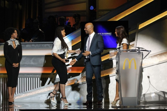 Pictured, Academy award-nominated filmmaker, Ava DuVernay accepts award from actor/rapper, Common alongside actress, Salli Richardson Whitfield at the 12th annual 365Black Awards. (Courtesy Photo)