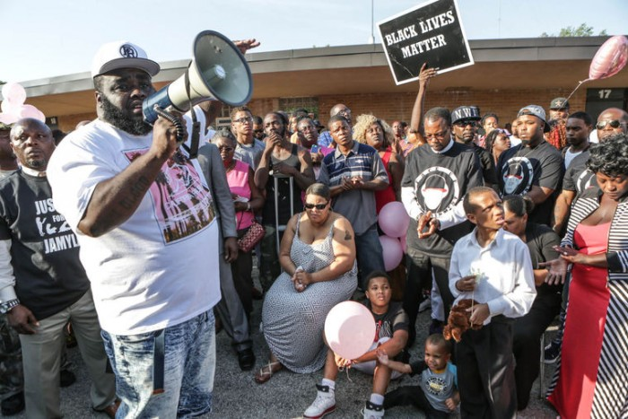 March organizer This'l addresses the crowd as the community comes to show their support for the family of Jamyla Bolden. (Lawrence Bryant/St. Louis American)