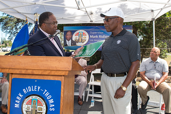 "Supervisor Mark Ridley- Thomas presents Charlie Sifford Jr.  with  a replica  ""Charlie Sifford Drive"" street sign (Courtesy Photo)"