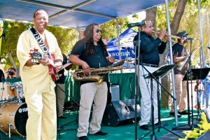 "The legendary Charles Wright (Front) and the 103rd Street Rhythm Band performs their classic, ""Express Yourself,"" to a standing room only audience at the 49th annual Watts Summer Festival stage at Ted Watkins Park."