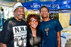 Mistress of Ceremonies, California Representative of the 43rd district, Maxine Waters, prepares to announce the next performer on the 49th annual Watts Summer Festival stage at Ted Watkins Park.