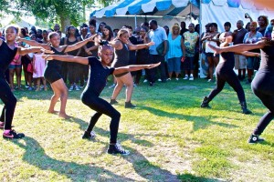 Young dancers wait to perform their hip-hop number for fans and supporters at the 49th annual Watts Summer Festival stage at Ted Watkins Park.