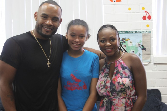 Shawn Finnie and Naturi Naughton pose with one of the young ladies from the Boys and Girls Club.  (Antonio de Graffenreaidt/ Saving Our Daughters)