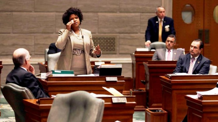 In this Sept. 10, 2014 file photo, Missouri state Sen. Maria Chappelle-Nadal wipes her eye as she speaks on the Senate floor in Jefferson City, Mo. Chappelle-Nadal, who was among the those tear gassed by police while protesting Michael Brown's shooting with her constituents in Ferguson, Mo., said as a state, Missouri has not done much. Lawmakers filed about 65 bills stemming from the events in Ferguson passing just one, a measure limiting municipal court fines and traffic tickets. (AP Photo/Jeff Roberson, File)