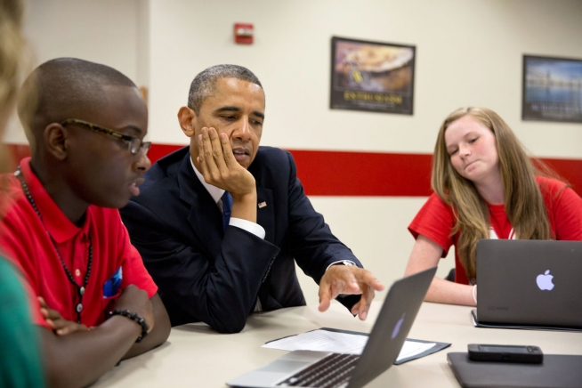 President Barack Obama views student project created on laptops during a tour at Mooresville Middle School in Mooresville, N.C. two years ago. The President has long aimed to close the digital divide. (PHOTO: Pete Souza/White House)