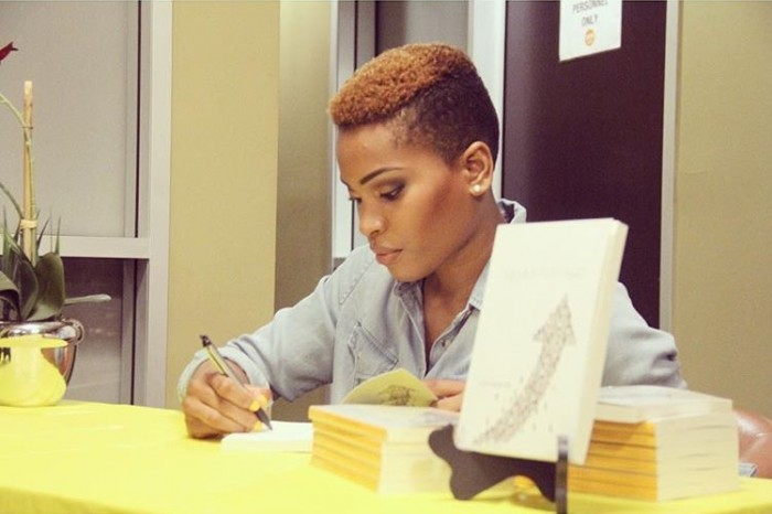 Author Stephanie Ike personally signs copies of Moving Forward (courtesy photo)