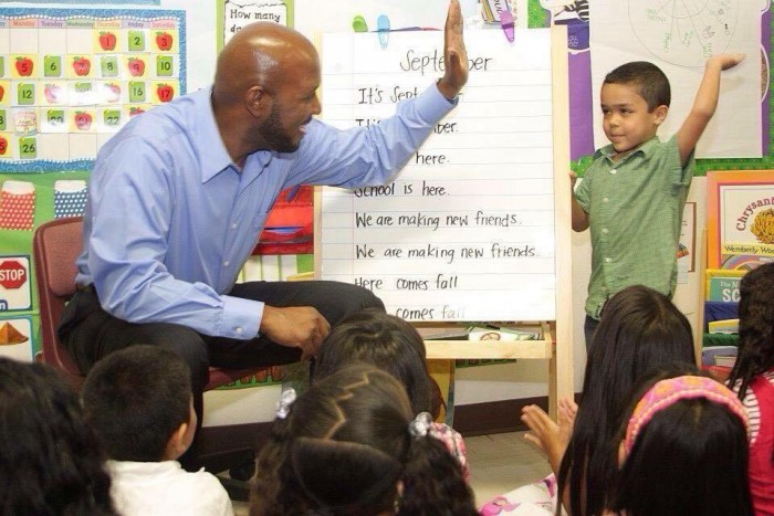 Compton Unified Board President Micah Ali high fives student from Today's Fresh Start, which was recently approved for charter school status (courtesy photo)