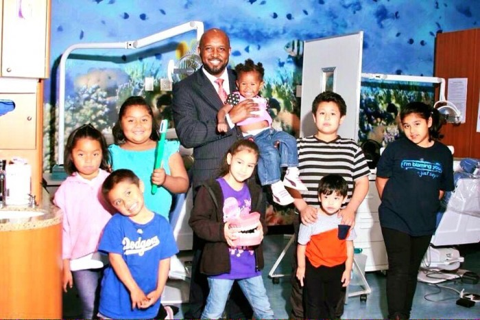 Compton Unified School District Board President Micah Ali poses with Today's Fresh Start Charter School students. (courtesy photo)