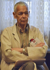"""Julian Bond listens to stories from people attending the """"Vietnam: The Power of Protest"""" rally at the New York Avenue Presbyterian Church in Northwest Washington, D.C. (Roy Lewis/The Washington Informer)"""