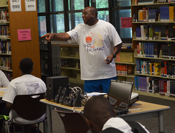 George Weaver interacting with students on the first day of the Books and Basketball Camp, August 3, 2015 (Amanda Scurlock/ LA Sentinel)