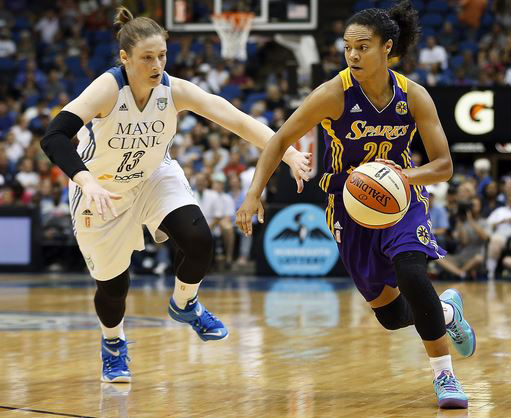 Los Angeles Sparks guard Kristi Toliver (20) pushes the ball down the court against Minnesota Lynx guard Lindsay Whalen (13) in the first half of a WNBA basketball game, Tuesday, Aug. 12, 2014, in Minneapolis. (AP Photo/Stacy Bengs)