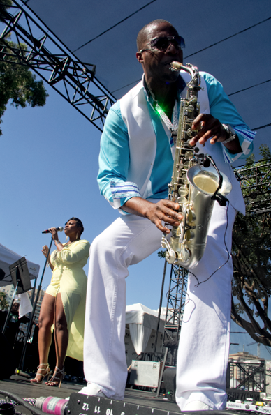 Saxophonist Eric Darius flows through the Long Beach Jazz Festival crowd that packed from the stage all the way back to the lagoon's shore and from festival gate across to the fence that separated the Rainbow Lagoon with the office building that shares the long walkways that stretch across the waters with cute wooden bridges. (Troy Tieuel/LA Sentinel)