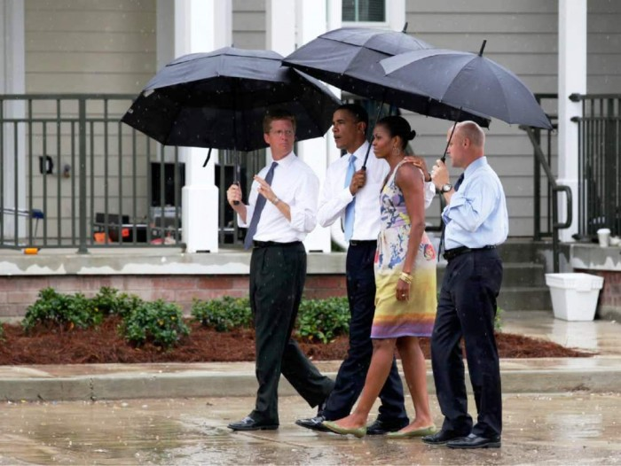 In this photo taken Aug. 29, 2010, President Barack Obama, first lady Michelle Obama, then-Housing and Urban Development Secretary Shaun Donovan, left, and New Orleans Mayor Mitch Landrieu, right, tour Columbia Parc Development in New Orleans on the fifth anniversary of Hurricane Katrina. President Barack Obama will visit New Orleans next week to mark the approaching 10th anniversary of Hurricane Katrina. (AP Photo/Carolyn Kaster)