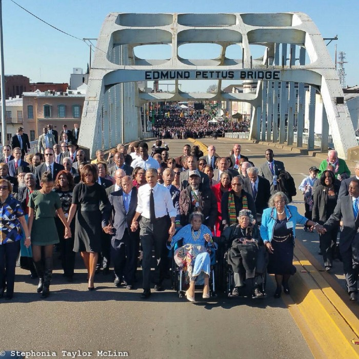 Boynton, in wheelchair next to President Obama, at 50th anniversary celebration of the Selma to Montgomery March (Photo by Stephonia Taylor McLinn).