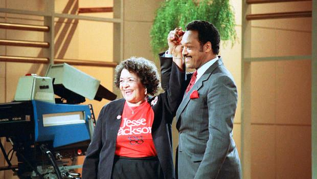 In an archival photo, Democratic presidential hopeful Rev. Jesse Jackson clasps hands with his mother, Helen Jackson, during taping of the Phil Donahue show in New York.  AP / BARRY THUMMA, FILE)