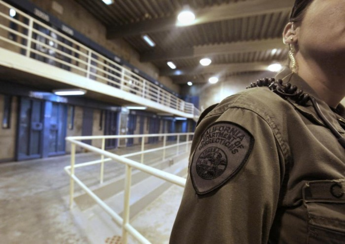 In this Aug. 17, 2011 file photo, a correctional officer is seen in one of the housing units at Pelican Bay State Prison near Crescent City, Calif. (AP Photo/Rich Pedroncelli)