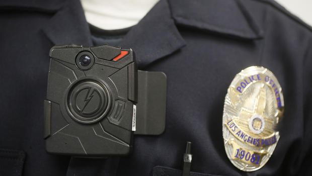 Patrol officers at the Mission Division in the San Fernando Valley began receiving body cameras this week as part of a roll out of 860 such cameras at three Los Angeles Police Department divisions over the next  month. (file photo)