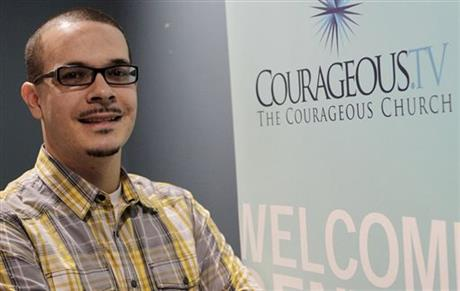 In this undated photo, Shaun King poses where he was the lead pastor of Courageous Church in Midtown Atlanta. King, a blogger who rose to prominence in the aftermath of a police shooting last summer in Ferguson, Mo., pushed back against claims by conservative bloggers that his parents were both white and that he exaggerated an assault he endured two decades ago while attending high school in Versailles, Ky. (Vino Wong/Atlanta Journal-Constitution via AP)