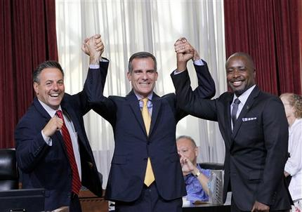 Councilman Joe Buscaino, left, with Los Angeles Mayor Eric Garcetti, center, and Councilman Marqueece Harris-Dawson celebrate after a city council vote in Los Angeles on Tuesday, Sept. 1, 2015. The Los Angeles City Council cleared the way Tuesday for Garcetti to strike agreements for a 2024 Olympics bid, putting the city on the verge of becoming the U.S. contender after Boston's awkward collapse. (AP Photo/Nick Ut)