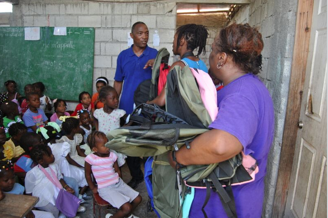 Michael Christopher at the Institut-Le Chandelier school in Croix des Bouquets, Haiti, giving out backpacks filled with school and art supplies to over 120 kids. (Courtesy photo)