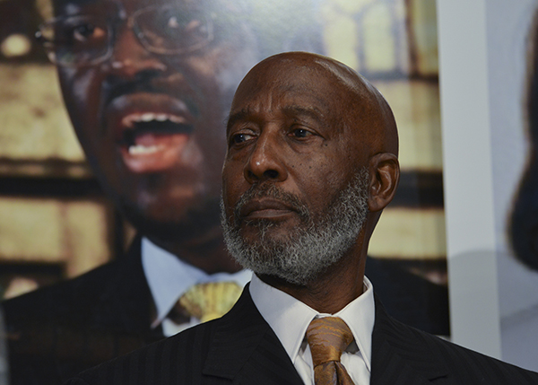 Bishop John R. Bryant, Senior Bishop AME Church listens to a speaker during a press conference with clergymen representing the African Episcopal Church (AME) at the National Press Club in Washington, D.C. on September 2. A portrait of the slain Rev. Clementa Pinckney of Emanuel AME Church in Charleston, S.C. is in the background. (Freddie Allen/NNPA News Wire Service)