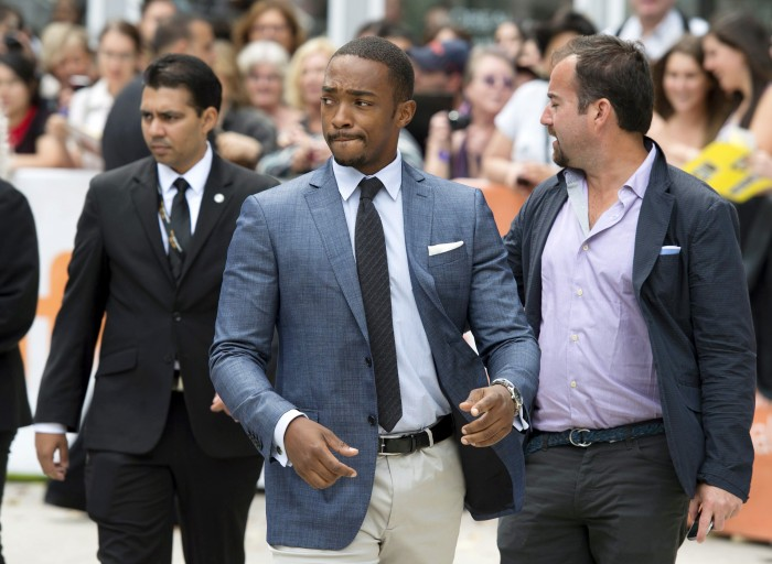 """Anthony Mackie arrives at the premier of the film """"Black and White"""" during the 2014 Toronto International Film Festival in Toronto on Saturday, Sept. 6, 2014. (AP Photo/The Canadian Press, Darren Calabrese)"""