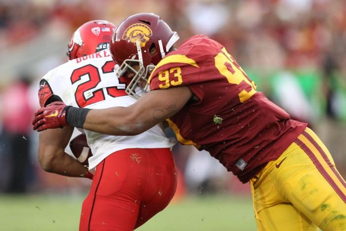 Defensive End Greg Townsend, Jr., takes down Utah's Devontae Booker Photo:  Jordon Kelly