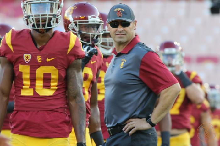 USC Head Coach Steve Sarkisian with Jalen Greene. Photo:  Jevone Moore
