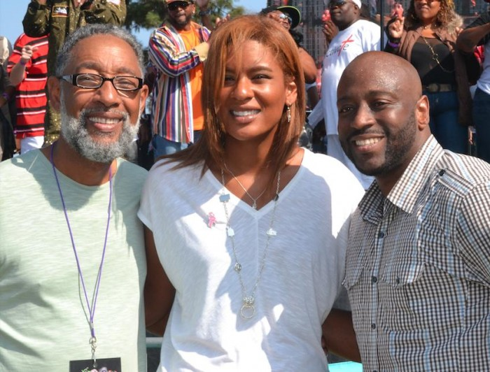 (L-R) Reggie Webb and his daughter, Kiana Webb, both members of the Black McDonald's Operators of Southern California, and J Redd, Christian comedian and emcee of the Gospel Stage. (photo by Danelle Cunningham)