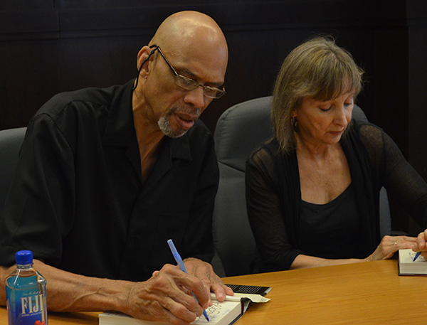Kareem Abdul-Jabbar and Anna Waterhouse (right) signing novels at Barnes and Nobel located at The Grove on September 27, 2015 (Amanda Scurlock/ LA Sentinel)