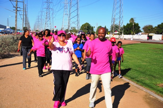 CUSD Board of Trustees Vice-President Satra Zurita (front and center) rallies for breast cancer awareness with her mother former City Councilwoman Delores Zurita (on Satra's right), sister City Councilwoman Janna Zurita (behind Delores), CUSD Board President Micah Ali (behind Janna), and hundreds of Compton families. (Courtesy Photo)