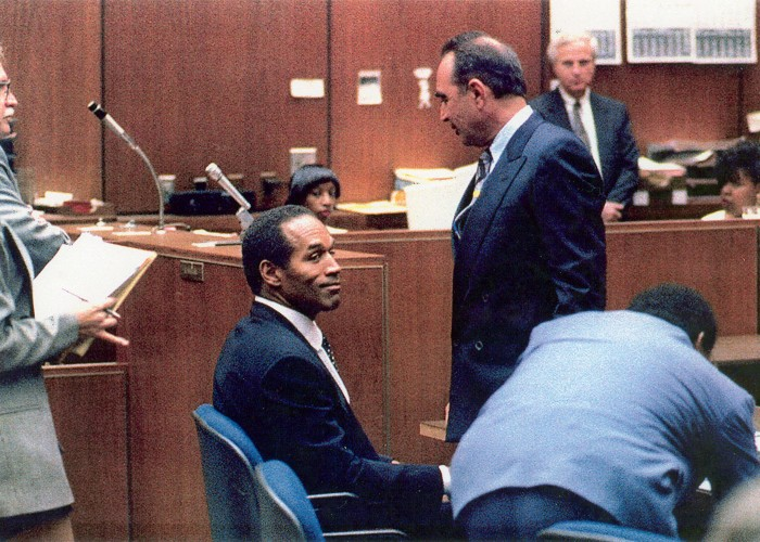 The Black Press was not welcomed by mainstream media into the O.J. Simpson double murder trial.  The black press had to go to court and get permission from the presiding judge of the O J. Simpson double murder trial.  Judge lance Ito to have a position in the courtroom.  The news photo service is said the Black Press did not have what it took to capture images along side them.  Judge Ito made a photo pool position for the Black Press of America.  It was the first time in the history of America that that whoever happened.  On my first day which incidentally was the first data Johnny Cochran came on the trial as O.J. Simpson's lawyer.  I captured an image of O.J. Simpson smiling in court for the first time and.  And mainstream media news organizations that said the Black Press the not have what it took to shoot beside them.  Had to call me to get the image because their photographers missed it.