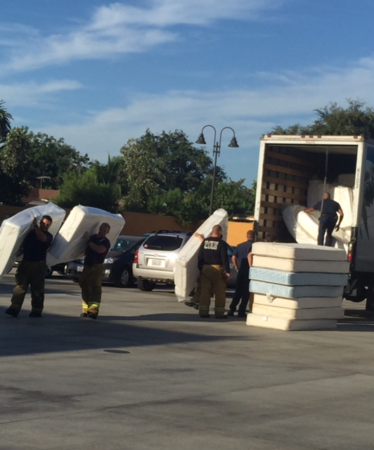 LA Firemen (Station 64) unloading Tempur-pedic mattresses from Sit 'n Sleep to outfit their sleeping quarters. (courtesy photo)