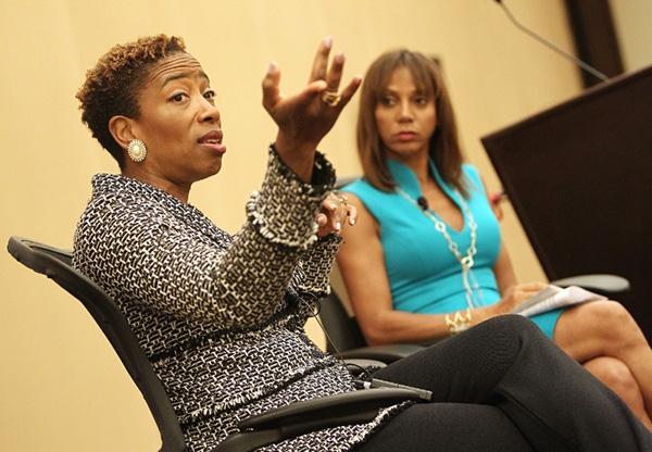 """During the """"Because We Care: The New Financial Normal"""" workshop hosted by The Black Women's Agenda, Inc. (BWA), Holly Robinson Peete (right) also spoke with panel participant Carla Harris, Vice Chairman, Global Wealth Management, Managing Director and Senior Client Advisor, Morgan Stanley. Harris was also presented with the BWA's 2015 Economic and Business Award. (PRNewsFoto/The Black Women's Agenda, Inc.)"""