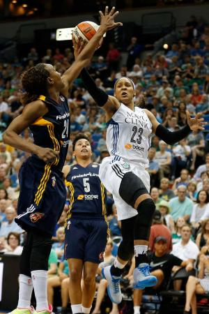 Minnesota forward Maya Moore shoots against Indiana forward Tamika Catchings in a Sept. 4 game. The teams met in the WNBA Finals in Minnesota (STACY BENGS/ASSOCIATED PRESS)